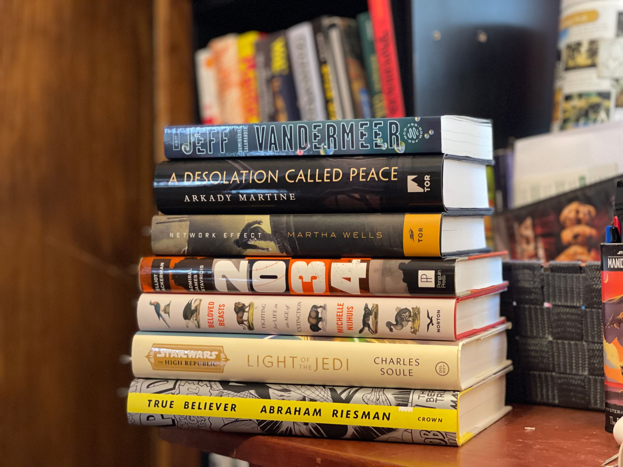 A stack of books sitting on a desk