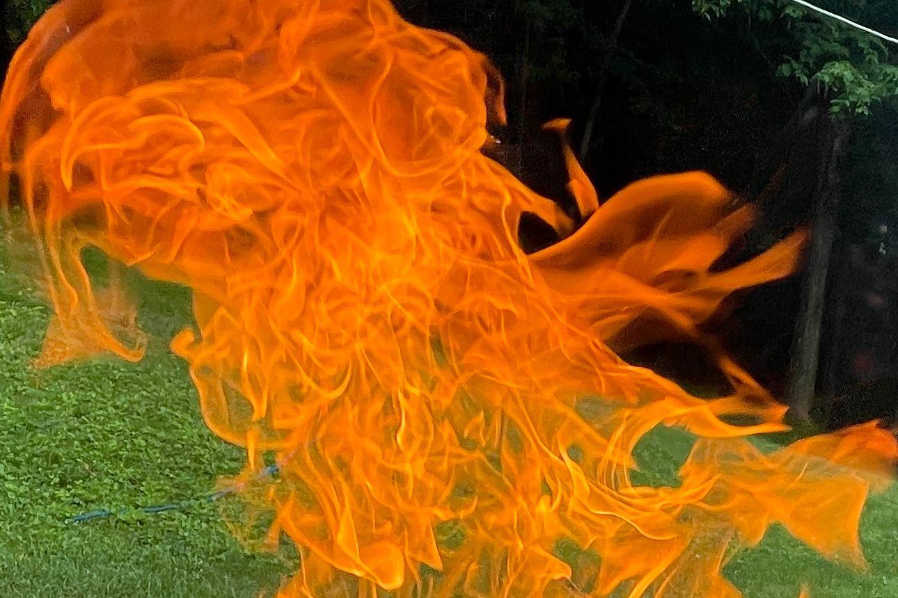 Flames set against a yard